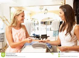 s assistant customer in clothing store royalty stock s assistant at checkout of clothing store stock image