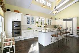 kitchen ceiling lighting design. The Impressive Cathedral Ceilings In This Kitchen Are Illuminated By Small  Wall Sconces That Help To Ceiling Lighting Design E