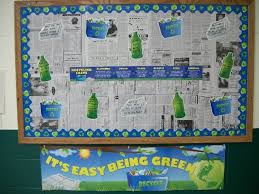 I like the idea of using recycled newspaper as the background paper for  this recycling bulletin board display. I would add student work as well