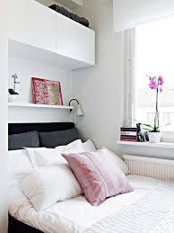 wall mounted storage cabinets over the bed