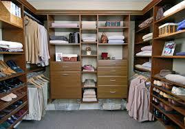 chestnut walk in closet features include slanted shoe shelving double hanging tilt out laundry hamper with drawer regular shelving standard drawer unit