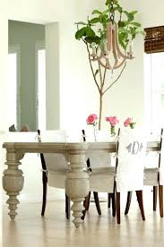love the dining room green slip covers great rug and light fixture it all chair slipcovers