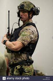 U.S. Air Force Senior Master Sgt. Brent Burch, pararescueman from the 308th  Rescue Squadron, Patrick Air Force Base, Florida, performs a radio check  before the start of the first day of training