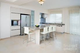 modern kitchen table. Appliances Photograph - Modern Kitchen And Dining Table By Noam Armonn