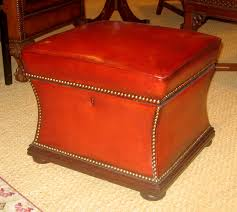 old red leather ottoman