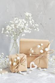 bouquet of small white flowers and wooden hearts stock photo images