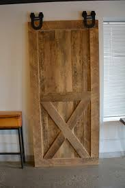 interior barn door in dining room with wallpaper and wall covering professionals