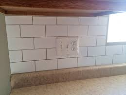 Create a custom backsplash with contact paper. The best part is its  removeable!