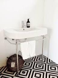 black and white floor tile room. i love black and white tiles chevron floor bathroom/remodelista tile room e