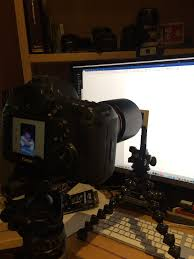 i set up one of my joby gorilla pods and a manfrotto clamp to hold the slides