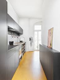 Small contemporary enclosed kitchen photos - Small trendy single-wall  yellow floor enclosed kitchen photo