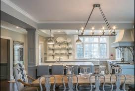 dining room with hanging linear chandelier lighting
