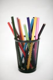Coloured pencil crayons in a container for use in sketching, drawing and  colouring in