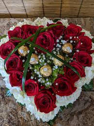 outstanding love gourmet ferrero rocher chocolates surrounded by more than one dozen red roses
