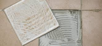 how to clean dry tile adhesive