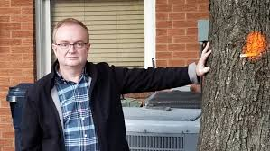 internet cable installation turns into nightmare for residents steve stinson stands beside the tree that will be removed from his property after workers cut into the roots steve stinson submitted