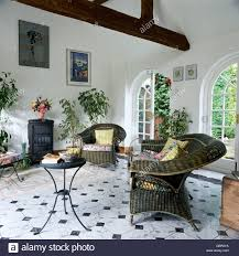 black and white tile floor living room. Exellent Room Grey Wicker Armchairs And Small Metal Table In White Living Room Extension  With Black Stove For Black And White Tile Floor Living Room L