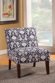 navy blue and white microfiber accent chair with ethnic pattern and espresso wooden legs on grey carpet over wooden floor