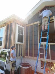windows are installed in new framing in preparation for adding exterior spray foam insulation