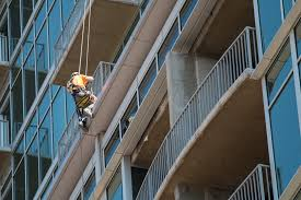 the glass house project featured a series of balcony repairs and sealants access was by swing stage and rope access