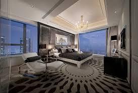 modern master bedroom with chrome varnished chandelier over king size bed