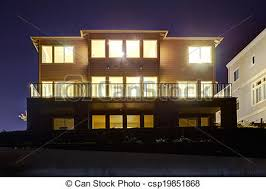 view modern house lights. House With Lights On. NIght View - Csp19851868 Modern