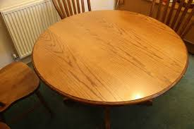 extending solid wood round oval pedestal dining table 6 chairs oak sold