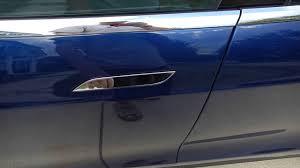 open tesla door handle when it does not pop out