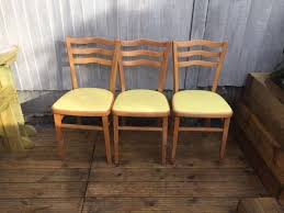 vintage wooden chairs x3 with lemon leather seats excellent condition