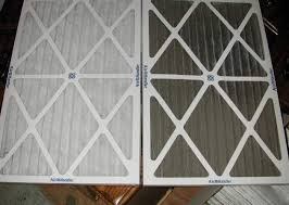 air conditioning filters. air conditioning filter change - dirty to clean filters