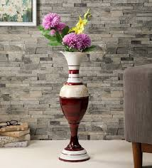 red long metal vase by ethnic