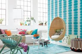 living room brown hanging chair teal stripes wall teal rug teal chair grey teal living room