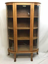 Fashioned from glass and hardwoods, these curio cabinets are ideal for displaying heirlooms, fine china, glassware and other collectibles. Sold Price Oak Curved Glass China Cabinet Paw Feet Antique Curvy Curio October 4 0118 2 00 Pm Edt