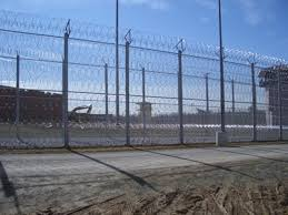 barbed wire fence prison. Chain Link Fences With Razor Wires Surrounding The Prison. Barbed Wire Fence Prison