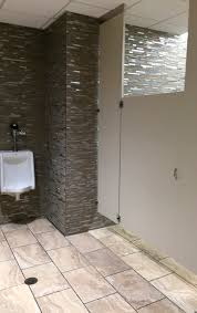 ntca member craftcroswell set the glass metal and stone mosaic wall tiles in the bathrooms with adesilex p10 while the daltile porcelain floor tiles were