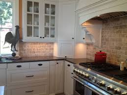 Kitchen Travertine Backsplash With White Cabinets And Black
