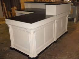 image of black l shaped reception desk