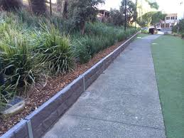 small retaining wall with sleepers