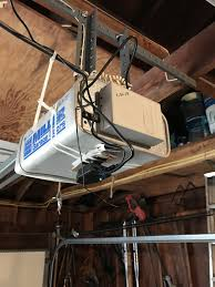 i attached the device with zip ties around the garage door opener and then shimmed it tight to keep it secure the laser ha the tape consistently
