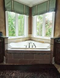 We updated this master bath with a plush bronze rug, and spa colored window  treatments