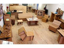 cardboard office furniture. at chairigami, i began by designing and inventing cardboard furniture for both yale students the new haven community, producing everything from beds to office r