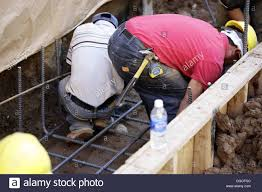 construction workers tying steel rebar for footing rebar worker