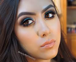 going to a party or out on the town and want to be the center of attention check out this makeup look i created bining a bright aqua blue glitter and a
