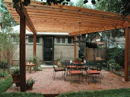picture of a wood pergola with a table and chairs
