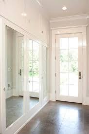mudroom with mirrored closet doors