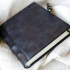 black leather journal vintage with silver lock and key