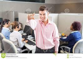 female customer service agent in a call center royalty stock customer service agent pointing in call center royalty stock photos
