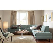 modern sectional sofas. Contemporary Sofas A Smallscale Sectional With Sophisticated Style Reese Adds Refinement  Details Like Button Tufting Precise Welting And Tall Tapered Legs Modern  Throughout Sectional Sofas