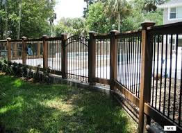 wrought iron privacy fence. Wood Frame Fence With Iron Bars And Gate Wrought Privacy