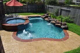 This small pool and spa in Katy Tx (Houston, TX) features stamped overlay